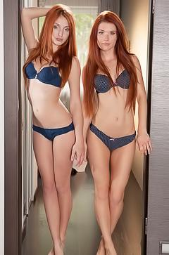 Two sexy redhead lesbians