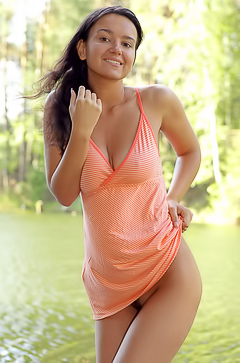 Sexy latina relaxing by the lake