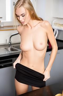 Nancy A stripping in kitchen