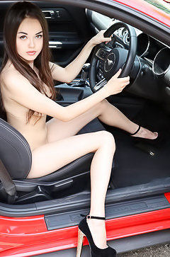 Li Moon stripping in sport car