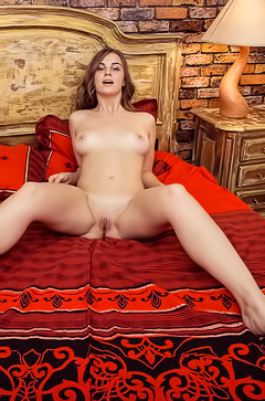 Bella Libre is nude on bed