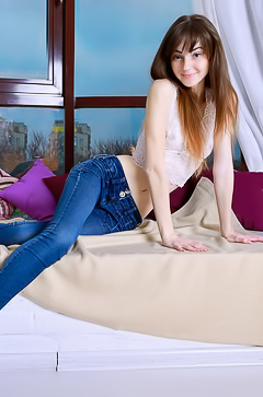 Young and slim teen in jeans