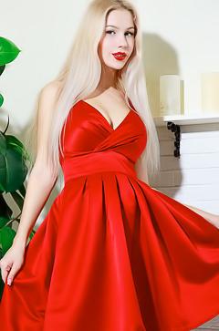 Genevieve Gandi in red dress