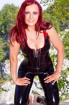 Redhead Lara Larsen in latex