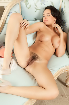 Busty Sanita is showing her hairy pussy