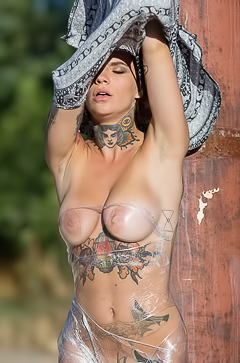 Tattooed busty brunette