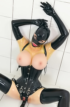 Fetish latex suit on busty babe