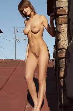 Naked brunette on the roof