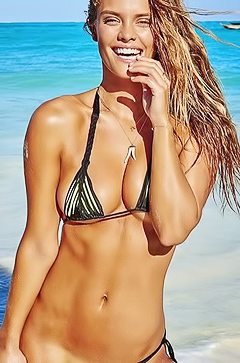 Nina Agdal posing in tight bikini