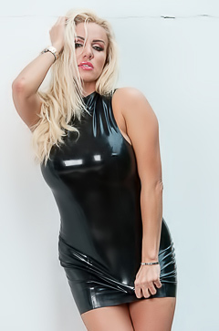 Blond Dannii Harwood posing in latex dress