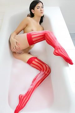 Lady Dee in sexy red stockings