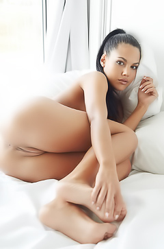 Sultry Senorita Apolonia is relaxing in her bed