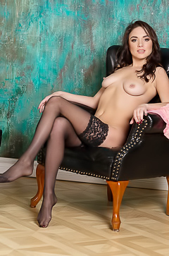 Nika - naked brunette in stockings