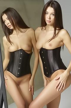 Sexy Nicolette Twins stripping in studio
