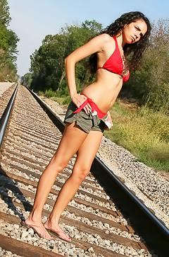 Sexy Kate strips on railroad