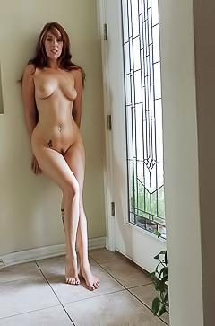 Lauren is taking off her clothes