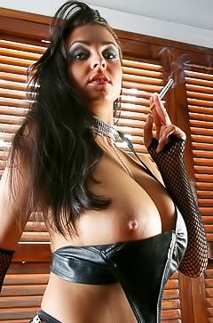 Busty Ewa Sonnet smoking in leather bra