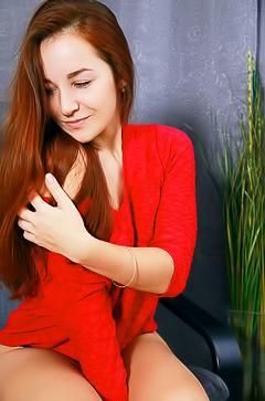 Young redhead Stefany Sonri stripping