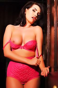 Ann Denise is taking off her pink lingerie