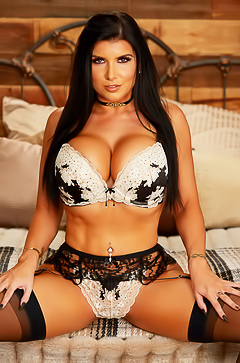 Big titted brunette star Romi Rain
