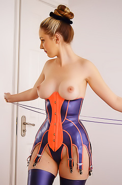Busty babe in latex suit