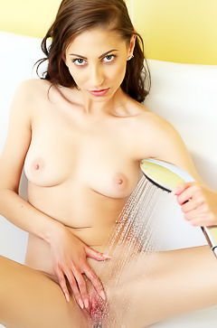 Horny Nicol Sweet is washing her pussy