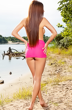 Stunning teen Niemira stripping on the beach
