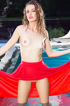 Playmate Elle Georgia swimming nude