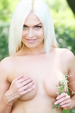 Busty blond stripping outdoor