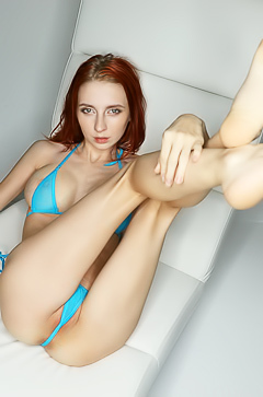 Slim redhead babe with huge silicone boobs