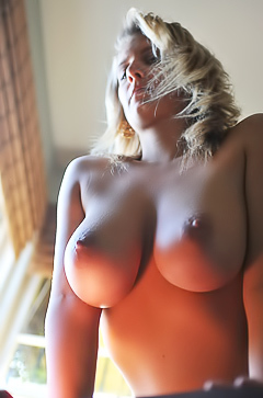 Jenny McClean showing her natural round boobs