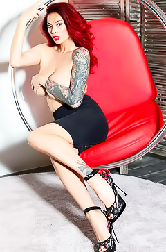 Pornstar Tera Patrick in Red Chair