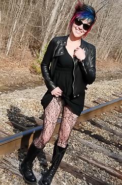 Goth babe Sabrina shows off