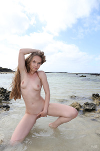 Teen Angel B Peeing On The Beach